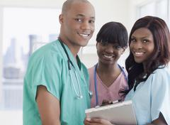 African doctor and nurses in hospital Stock Photos