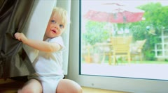 Cute Baby Playing Hide Seek - stock footage