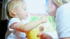 Cute Baby Practicing Using Spoon  Stock Footage