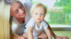 Young Mother Child Playing on Floor Stock Footage