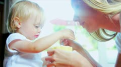 Little Girl Learning Feed Herself Stock Footage