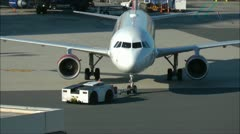 Airplane tow tug tow bar Stock Footage