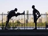Stock Photo of african men stretching on railing