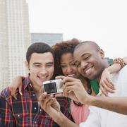 Friends taking self-portrait Stock Photos