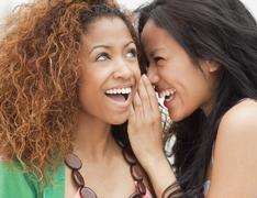 women gossiping - stock photo