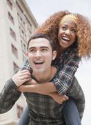 man piggybacking woman - stock photo