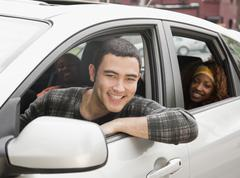 Friends riding in car Stock Photos