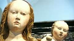 Virgin mary with baby child jesus statue Stock Footage