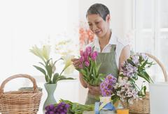 Stock Photo of chinese florist arranging flowers