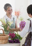 Stock Photo of chinese florist giving flowers to customer