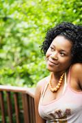 African woman looking pensive on patio Stock Photos