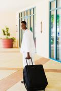 African man pulling suitcase Stock Photos