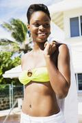 african woman wearing bikini top - stock photo