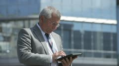 Modern senior in business - stock footage