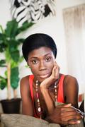 African woman with head in hands Stock Photos