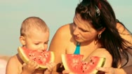 Stock Video Footage of Family Eating Watermelon On The Beach