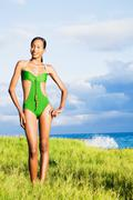 African woman in bathing suit with ocean in background Stock Photos