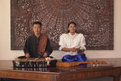 Stock Photo of asian man and woman with traditional musical instruments