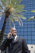 African businessman talking on cell phone Stock Photos