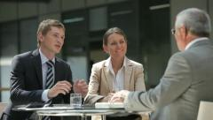 Gathered for discussion Stock Footage