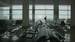 Lonely traveller at the airport Stock Footage