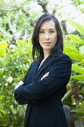 japanese businesswoman with arms crossed - stock photo