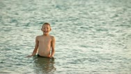 Child in the Sea Stock Footage