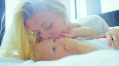 Young Caucasian Mother Holding Baby Bed - stock footage