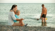 Young Family on a Summer Beach Stock Footage