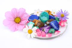 Gemstones and flowers Stock Photos