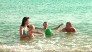 Young Family On The Beach Stock Footage