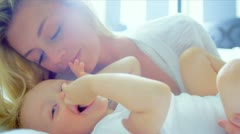 Little Blonde Haired Girl Playing Mother Stock Footage