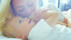 Close Up Blonde Mom Holding Young Child Bedroom Stock Footage
