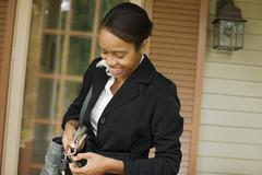 African businesswoman searching for house key Stock Photos