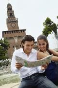 Couple sightseeing and looking at map Stock Photos