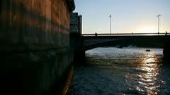 London Sunset over Blackfriars Bridge with shadows hitting wall - stock footage