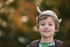 Mixed race boy in viking hat outdoors Stock Photos
