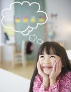 Chinese girl with thought bubble in classroom Stock Illustration