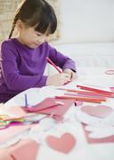 chinese girl making valentine's day cards chinese girl making valentineõs day ca - stock photo