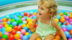 Cute Blonde Child Enjoying Ball Play Stock Footage