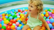 Stock Video Footage of Cute Blonde Child Enjoying Ball Play