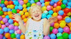 Cute Blonde Child Enjoying Ball Pool - stock footage