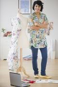 Hispanic woman standing with dressmaker's dummy hispanic woman standing with dre Stock Photos