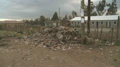 Garbage on slum street Stock Footage