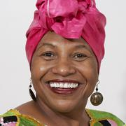 African american woman in pink headdress Stock Photos