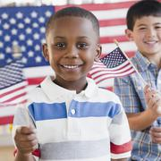 boys holding small american flags - stock photo