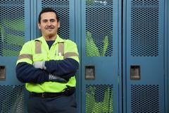 Hispanic sanitation worker in locker room Stock Photos
