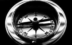 Retro Compass Black Background - stock photo