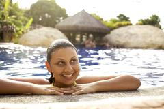 Smiling mixed race woman in swimming pool Stock Photos