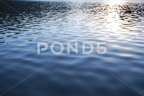 Stock photo of Vibrant water texture with sunlight reflection